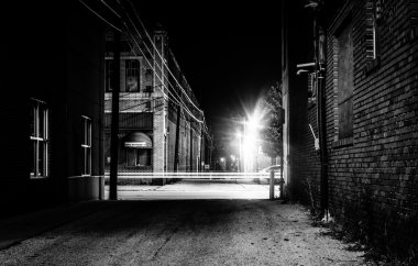 Dark alley and light trails in Hanover, Pennsylvania at night.