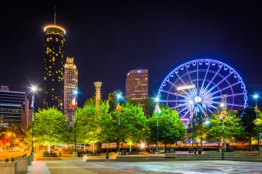 Ferris wheel and buildings seen from Olympic Centennial Park at