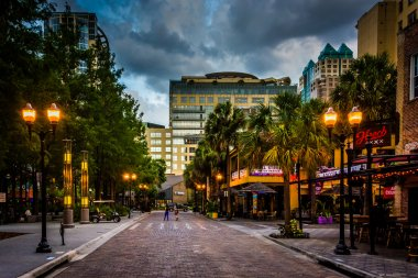 Storm clouds over a brick street in downtown Orlando, Florida.