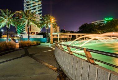 The Friendship Fountains and buildings at night in Jacksonville,
