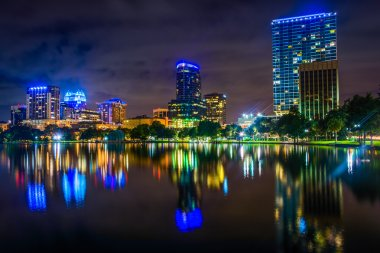 The skyline reflecting in Lake Eola at night, Orlando, Florida.