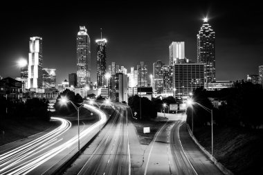 Traffic on Freedom Parkway and the Atlanta skyline at night, see