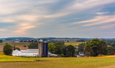 View of a barn and silos on a farm in rural Lancaster County, Pe
