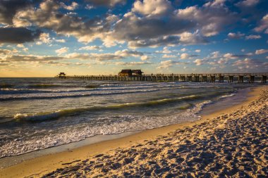 Evening clouds over the fishing pier and Gulf of Mexico in Naple