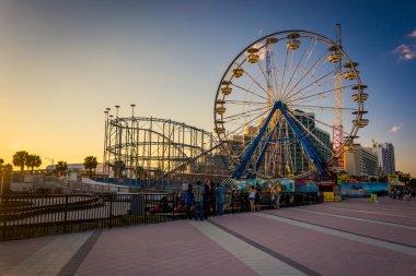 Ferris wheel and roller coaster along the boardwalk in Daytona B