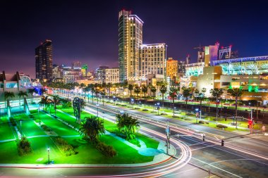 View of Harbor Drive and skyscrapers at night, in San Diego, Cal