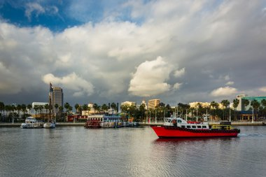 Dramatic stormy sky over buildings and boats in Long Beach, Cali