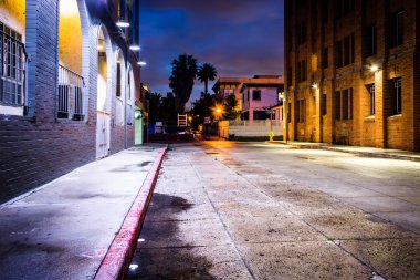 A dark street at night, in Venice Beach, Los Angeles, California