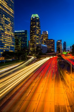 Traffic on the 110 Freeway and the Los Angeles Skyline at night,