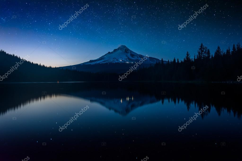 Stars in the night sky and Mount Hood reflecting in Trillium Lak