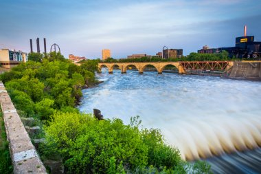 Dam on the Mississippi River and the Stone Arch Bridge, in Minne