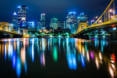 The Pittsburgh skyline reflecting in the Allegheny River at nigh