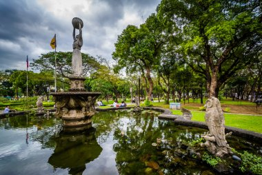 Statues and fountain at the University of Santo Tomas, in Sampal