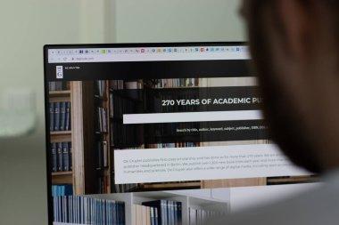 New York, USA - 1 May 2021: Walter de Gruyter company website on screen, Illustrative Editorial