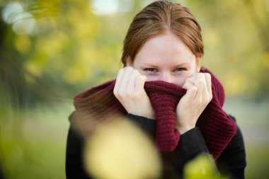 Woman with a Scarf in the Fall or Autumn