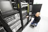Photo It consultant monitors servers in datacenter
