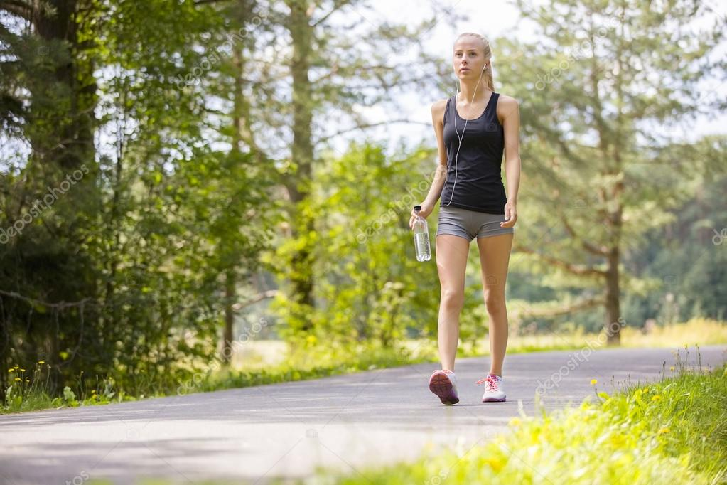 Woman walking outdoor in the forest as workout