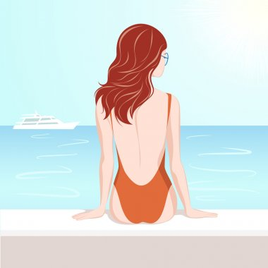 Girl in swimsuit looking at the sea
