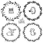 Vintage koszorúk, a betűk és a kis állatok