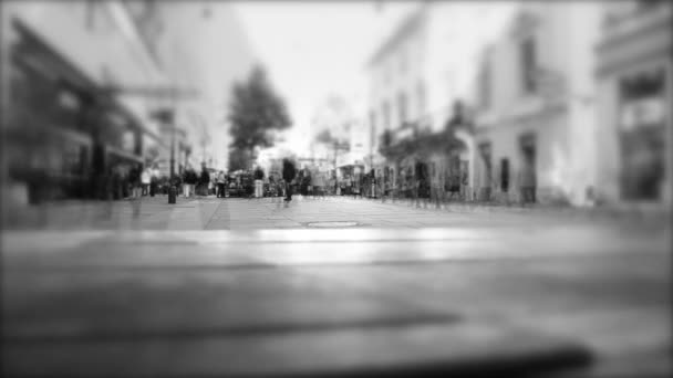 people walking on the busy street , rush hour and shopping day , big cerowd of people walking in centrum of city