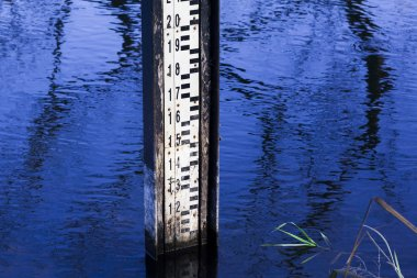 Water level measurement gauge during flood.