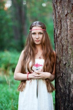 Young pagan Slavic girl with a dagger