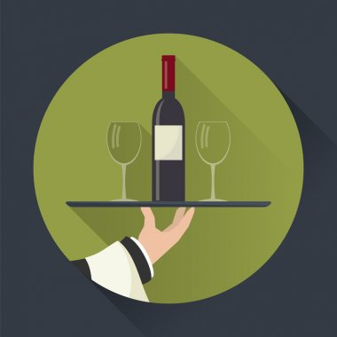 Waiter with wine bottle and wine glasses