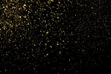 Gold glitter texture on a black background. Holiday background. Golden explosion of confetti. Golden grainy abstract  texture on a black  background. Design element. Vector illustration,eps 10. clip art vector