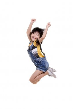 Happy little Asian child jumping