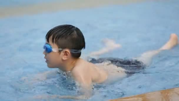 Little Asian Child playing in Aqua park .