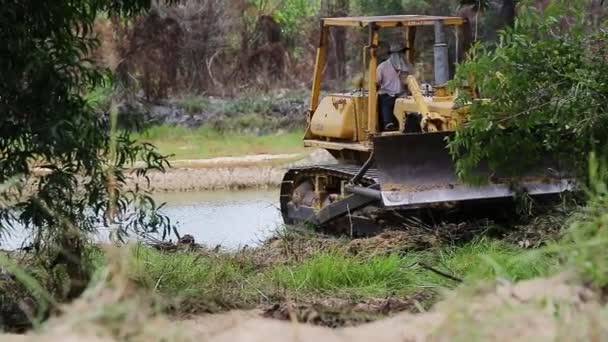 Unidentified worker control Bulldozer to excavator grader removing the ground