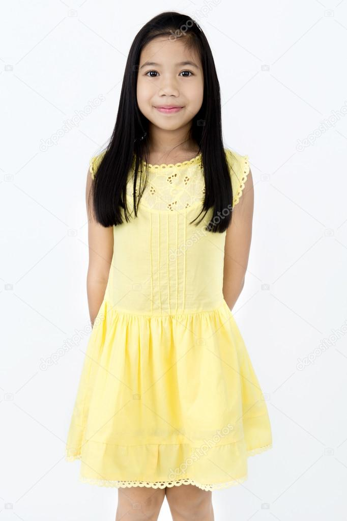 Portrait Of Little Asian Girl With Smiles Face Stock Photo