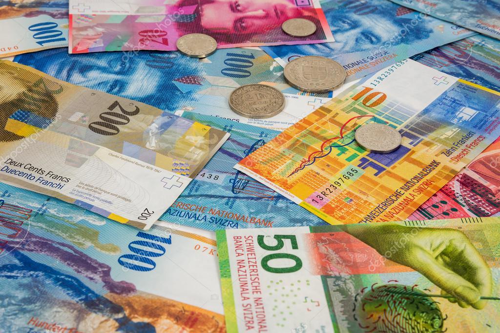 schweizer franken banknoten und m nzen als hintergrund stockfoto mkos83 115410476. Black Bedroom Furniture Sets. Home Design Ideas
