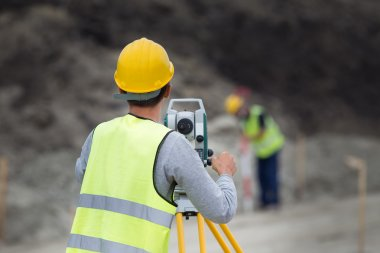 Workers with theodolite