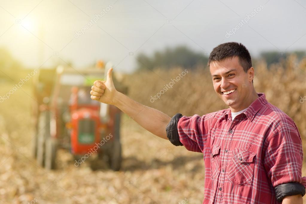 Satisfied farmer in field