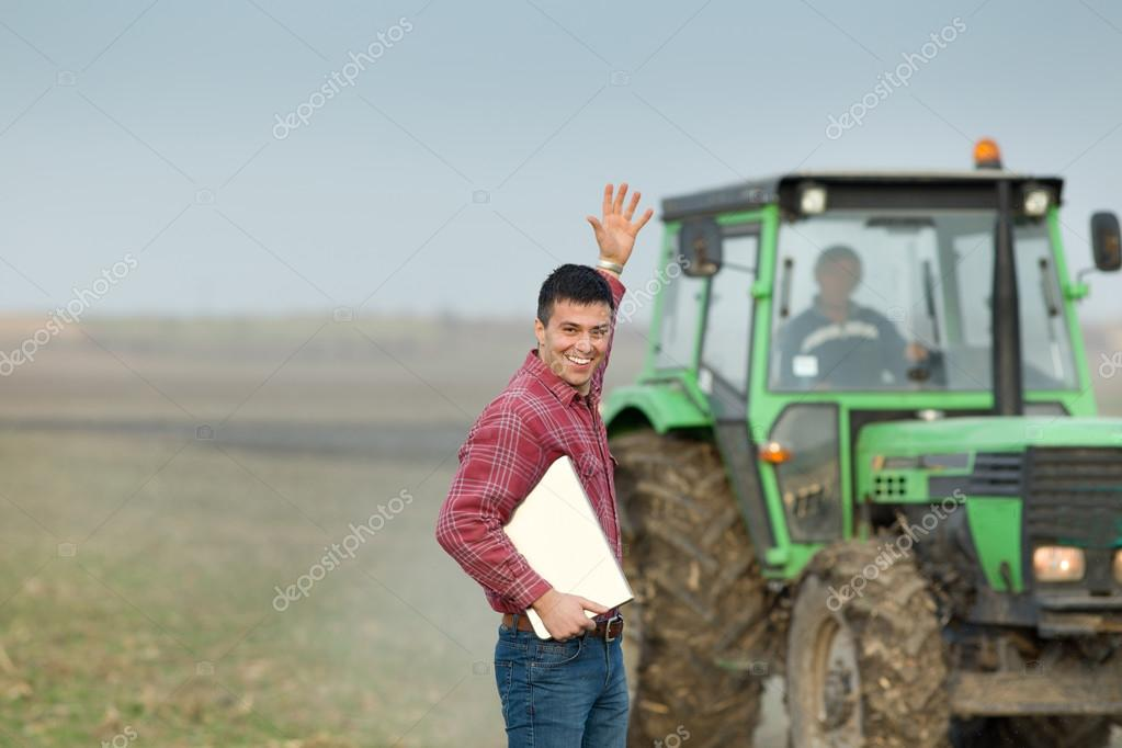 Enthusiastic farmer on farmland