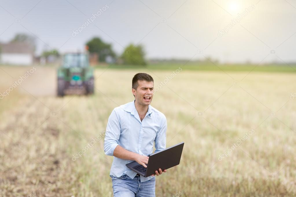Young farmer yelling in the field