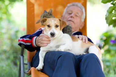 Senior man with dog and cat