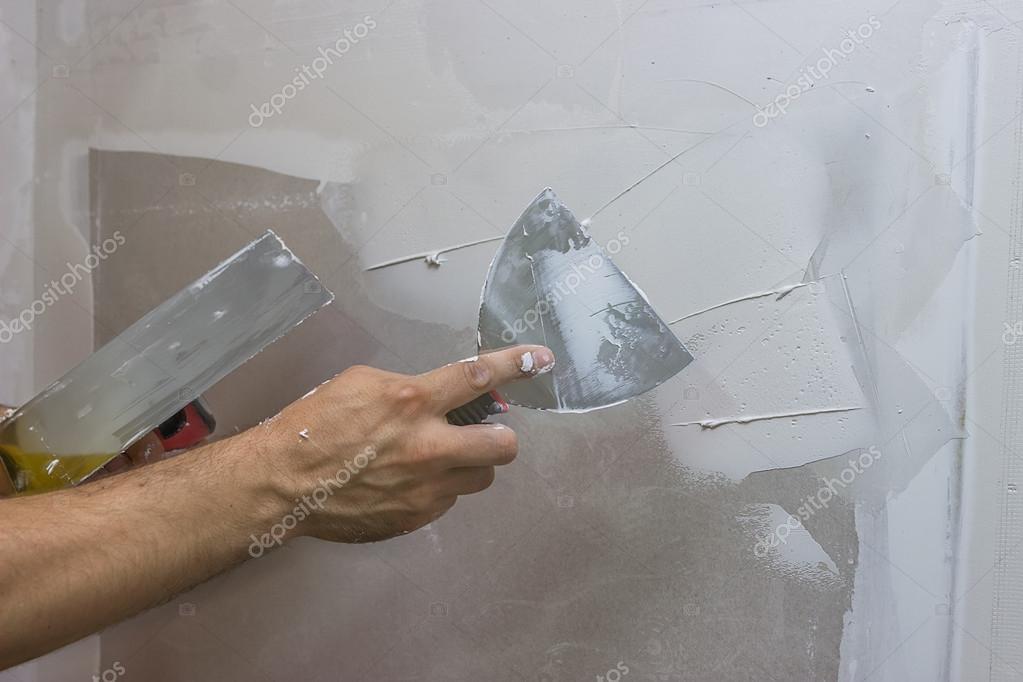 男人手用镘刀抹灰墙 2 图库照片 169 Kataklinger#57513713