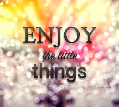 Enjoy the little things quote on bokeh background