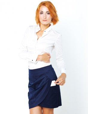Young beautiful business woman with white business card in hand. Office worker. Office Style