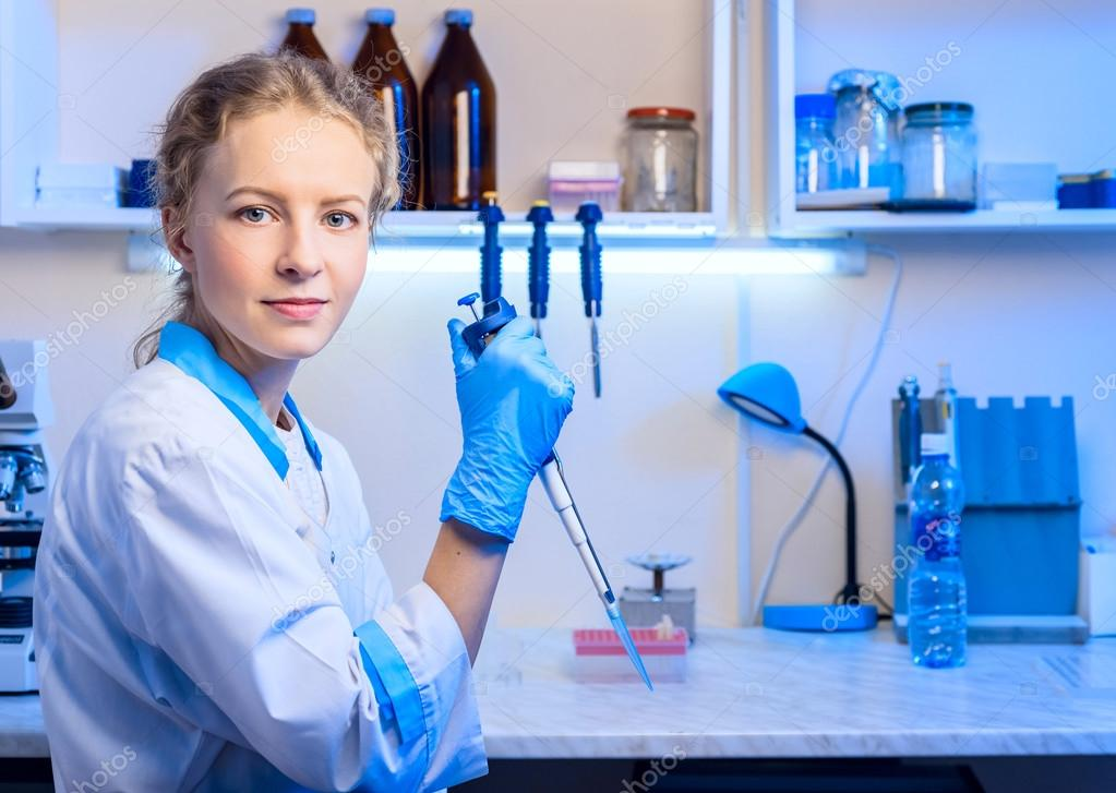 Woman Scientist Biochemist At The Workplace Makes The Analysis In