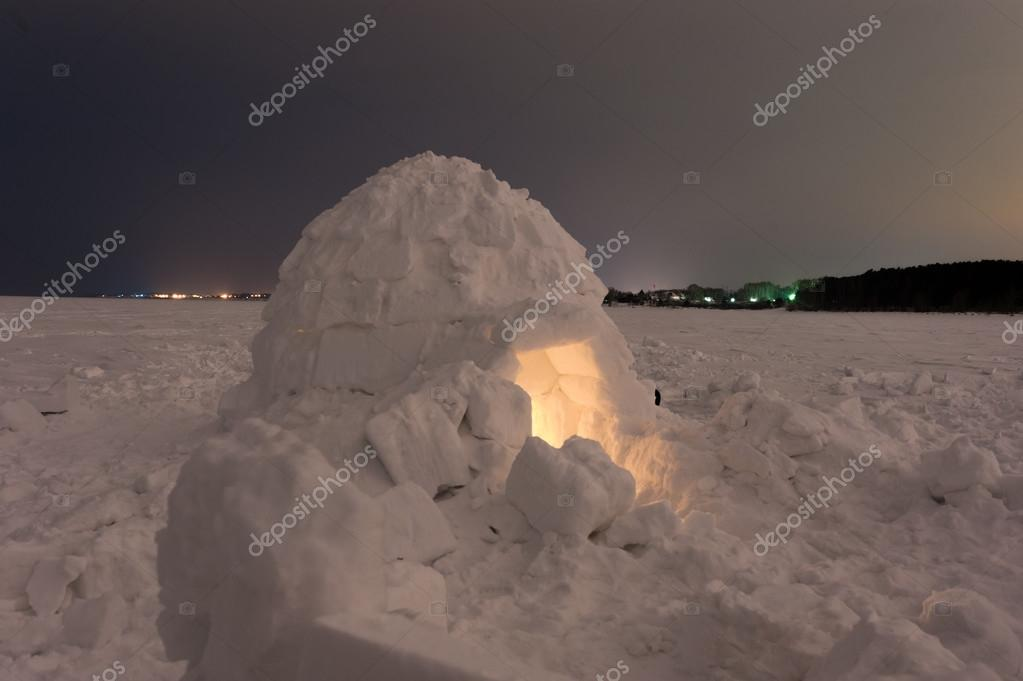 Snow igloo on the frozen sea at night