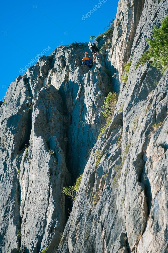 A bunch of climbers on a route on a cliff