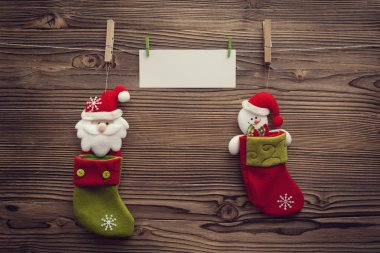 empty xmas greeting card attached to clothespins between socks