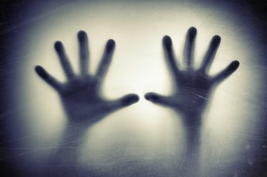 Hands behind frosted glass. depression, fear, panic, scream concept.