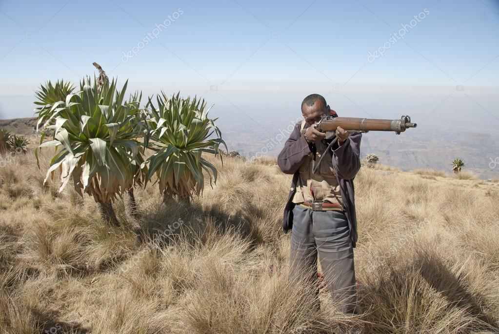 Park scout shows his rifle in Simien N. P., Ethiopia.