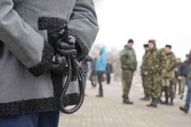 Cossack whip at the mourning rally dedicated to Boris Nemtsov murder, Voronezh, Russia.