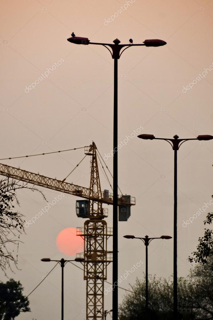 Sunset with lights and construction, New Delhi, India.
