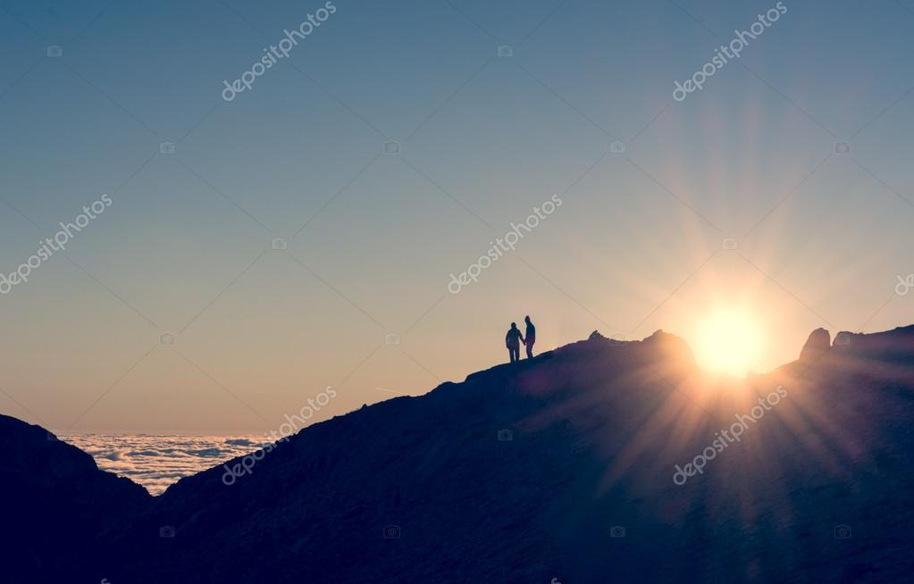 Silhouette of a couple holding hands